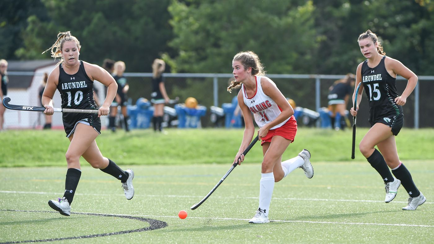 Spalding's ally Keith (11) bounces the ball off her stick as she charges down the field, chased by Arundel defenders.  Archbishop Spalding will host field hockey at Arundel High School on Thursday, September 10, beating them 5-1 in regular time.  09.09.21