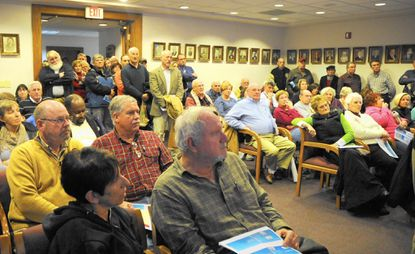 An overflow crowd of angry residents expressed their frustration with a proposed ordinance to lower utility connection fees for the Greenway Farm apartment community in Havre de Grace.