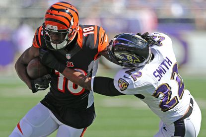 Cincinnati Bengals wide receiver A.J. Green (18) is tackled after a catch by Ravens cornerback Jimmy Smith (22) at M&T Bank Stadium.
