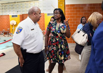 Baltimore Police Commissioner Michael Harrison and Baltimore City Public Schools CEO Dr. Sonja Santelises chat during a tour at Vivien T. Thomas Medical Arts Academy on the first day of the school last year.