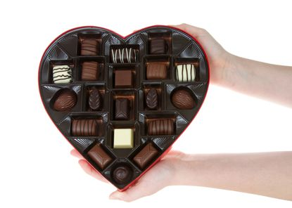 Heart shaped box with chocolate candies are a common gift for Valentine's Day.