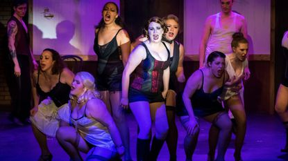 """Megan Mostow as Sally Bowles with the Kit Kat boys and girls in Silhouette Stages' production of """"Cabaret."""""""