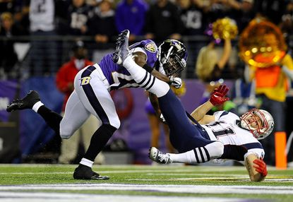 Baltimore Ravens safety Ed Reed breaks up a pass in the end zone intended for New England Patriots wide receiver Julian Edelman in the first half of the Ravens' Sept. 23 win over the Patriots in Baltimore.