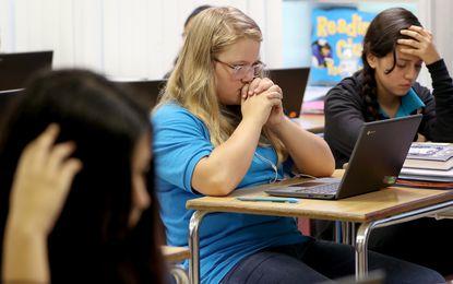 Seventh graders Samantha Spears, in blue, and Valerie Trujilllo take an assessment test in Kristen Ballestero's class at Palm Beach Maritime Academy, a charter school in Lantana, Fla. Sept. 6, 2019.