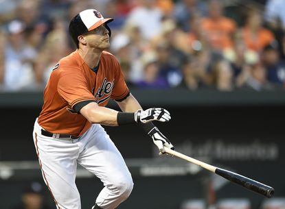 OriolesoutfielderNolan Reimold watches his two-run home run against the New York Yankees during the third inning Saturday, June 13, 2015, in Baltimore.