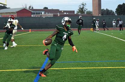 Tyree Sheppard scores Milford Mill's second touchdown in the third quarter against New Town in the Millers' season opener on Friday night.