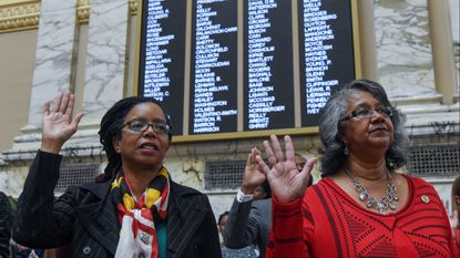 Delegates Robbyn Lewis (L) and Cheryl Glenn (R) are sworn into the Maryland House of Delegates for the 2019 session in the House of Delegates chamber at the State House in Annapolis.