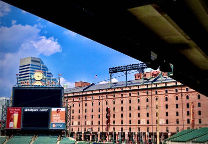A view looking at the warehouse beyond the right field bleachers during team practice at Oriole Park at Camden Yards on Saturday, July 4, 2020. (Karl Merton Ferron / Baltimore Sun staff)