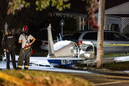 A single-engine Piper Cherokee Arrow airplane came to rest on Stone Street after the pilot made an emergency landing near the Wilkes-Barre/Scranton International Airport in Moosic, Pennsylvania on September 20, 2020.