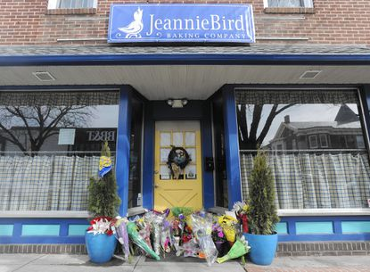 Flowers have been placed outside the JeannieBird Baking Company on Main Street in Westminster in memory of Jeannie Vogel who was killed in a traffic accident early in the morning of February 19.