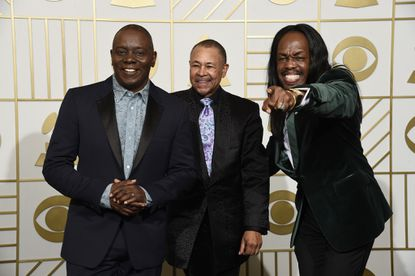 Earth, Wind & Fire (from left: Philip Bailey, Ralph Johnson and Verdine White) pose in the press room at the 58th annual Grammy Awards on Feb. 15. The group performs at Royal Farms Arena on Tuesday with Chicago.