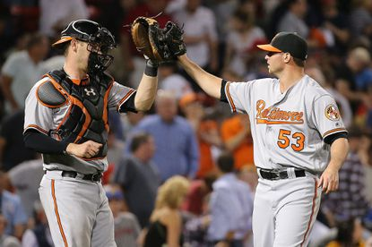 Zach Britton (53) of the Baltimore Orioles and Matt Wieters celebrate after defeating the Boston Red Sox at Fenway Park on June 14, 2016 in Boston.