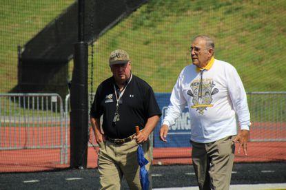 Jim Darcangelo, a National Lacrosse Hall of Famer, died of a heart attack on Saturday morning. Here he walks with Carl Runk (on right).