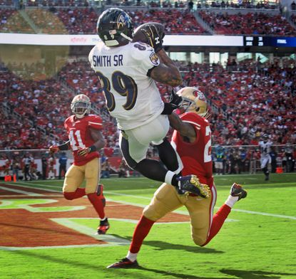 Ravens wide receiver Steve Smith Sr. beats the 49ers' Kenneth Acker, right, for a 34-yard touchdown in the third quarter at Levi's Stadium.