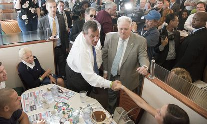 New Jersey Gov.Chris Christie and MarylandGov.Larry Hogan greetthe public in an Annapolis dinner over the summer afterHogan endorsed his bid for the Republican nomination for president. Christie will be back in Annapolis Thursday for a fundraiser