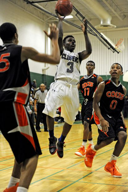 Patterson's Aquille Carr shoots a one-handed floater between Coolidge defenders Maurice Jeffers and Omar Roberts.