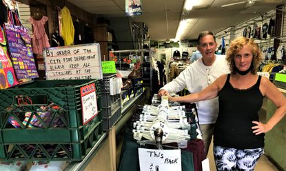 At Jerry's Bargains on West Lexington Street in Baltimore, Robbie and Linda Silverman have been running the store their father established in 1963. The family plans to close the store, but it is still open during the pandemic for its annual sale of back-to-school uniforms. Sales have been off up to 40 percent, however.