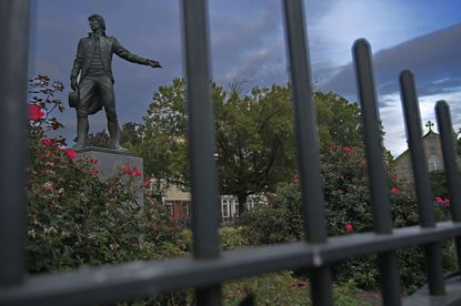 Surrounded by iron fencing, a statue of Capt. John O'Donnell (1749-1805) stands in the middle of Canton, nestled in the center of the commercial district. (Karl Merton Ferron/Baltimore Sun Staff)
