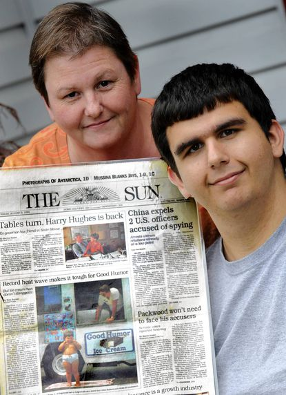 John Boias and his mother, Beth Boias, with the 1995 copy of The Baltimore Sun and the photo that ran of him at 3 years old in his underwear and eating ice cream.
