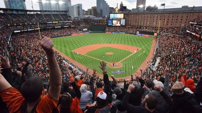 Fans cheer Mark Trumbo's home run in the bottom of the 11th for the win against the Toronto Blue Jays on Orioles' Opening Day. (Jerry Jackson/Baltimore Sun)