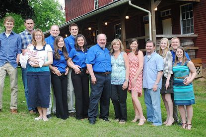 From left to right: Adam Smith, Kevin McFeaters, Melissa McFeaters (daughter of Ron Smith), Brian Smith, Rachel Smith (wife of Brian Smith), Eric Smith, Clarissa Gonyea (fiance of Eric Smith), Ron Smith, Deanna Smith (wife of Ron Smith), Andrea Dorsey (daughter of Ron Smith), Jason Dorsey, Katie Smith, William Smith and Carlee Smith are shown at Carroll Water Systems' 30th anniversary event May 17.