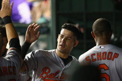 Orioles outfielderDariel Alvarez celebrates a run in the fifth inning against the Texas Rangers at Globe Life Park on Aug. 29, 2015 in Arlington, Texas.