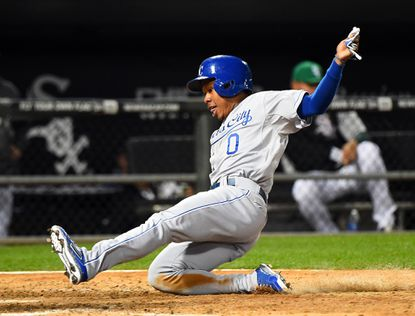 Kansas City Royals base runner Terrance Gore scores a run against the Chicago White Sox during the eighth inning at U.S Cellular Field.