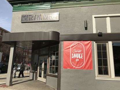 Secret Sauce Co. has opened a restaurant, bar and video game arcade at the old North Avenue Market in the Station North Arts District.