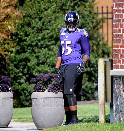 Ravens linebacker Terrell Suggs tries to avoid cameras as he prepares for his second day of practice Thursday.