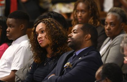 September 27, 2019 -- Baltimore State's Attorney Marilyn Mosby and Delegate Nick Mosby listen to Rev. Jesse Jackson at the 28th annual Civil Rights Breakfast at the War Memorial Building.