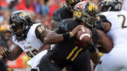 Maryland quarterback Kasim Hill (11) looks for an open receiver down field during the team's matchup against the Towson Tigers on Saturday. Hill completed 13 of 16 passes for 163 yards and two touchdowns in his first college start.