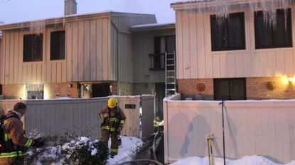 Howard County fire crews rescue man from burning townhouse in Columbia