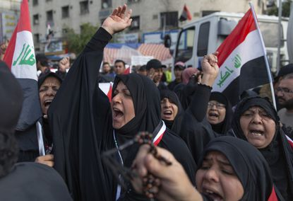 Anti-government Iraqi women protesters chant anti-Iran and anti-U.S. slogans during the ongoing protests in Tahrir square, Baghdad, Iraq on Friday, Jan. 10, 2020.