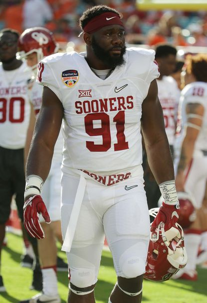 Oklahoma defensive end Charles Tapper warms up before the start of the Orange Bowl NCAA college football semifinal playoff game against Clemson.