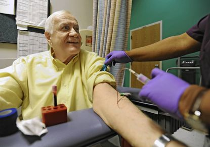 Ronald Jerro, who has MDS,has his blood drawn by oncology lab technician Antoinette Chappell-Williamson at Johns Hopkins Hospital.