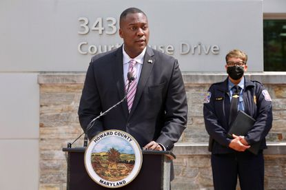 Howard County Executive Calvin Ball (front) and Police Chief Lisa Myers put their support behind keeping and changing the school system's school resource officer program during a press conference on Wednesday, April 21.