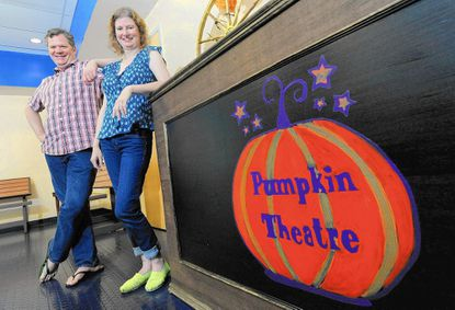 Raine Bode, right, of Roland Park, artistic director at Pumpkin Theatre, and her husband, Dana Whipkey, business manager at Pumpkin Theatre, stand in the lobby of the children's theater nonprofit based at Har Sinai Congregation in Owings Mills, Monday, July 6.