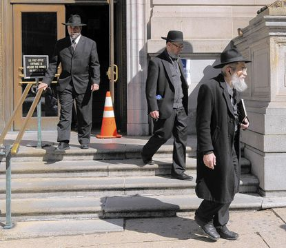Members of the Baltimore Jewish community leave Courthouse East after a hearing for Wayne Stephen Young, who was convicted in 1969 of killing 11-year-old Esther Lebowitz.
