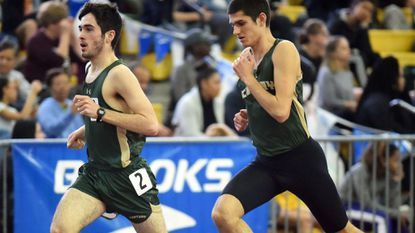 Century teammates Zach Fenton, left, and Jacob Spera run together in the 2A boys 3200 meter run during the MPSSAA State Indoor Track and Field Championships at Prince George's Sports & Learning Complex on Monday, Feb. 19.
