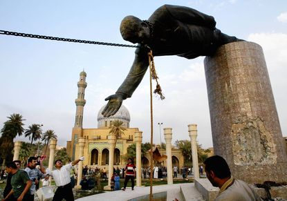 U.S. Marines pull down the statue of Saddam Hussein in Baghdad on April 9, 2003.