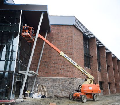 In this March 31 photo, progress continues with workers on the job at the new Havre de Grace Middle and High School building. Work at the site cease April 7 after a work died from the novel coronavirus.
