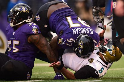 Quarterback Blake Bortles (5) of the Jacksonville Jaguars is tackled by Ravens defensive tackle Timmy Jernigan (97) in the second half at M&T Bank Stadium on Dec. 14, 2014 in Baltimore.