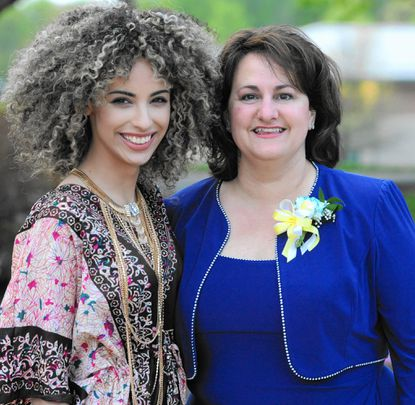 """Former student Shi Scott, left, poses for a photo with Principal Christina Douglas during Church Creek Elementary's 20th anniversary celebration at Harford Community College. Scott was a contestant on """"The Voice"""" and """"American Idol."""""""