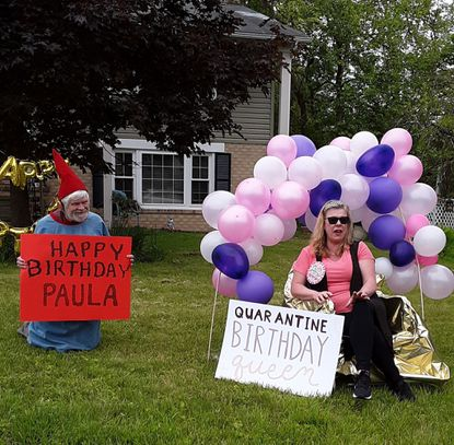 Garden gnome Ed Lilley helps Paula Bahler Huber celebrate her birthday.