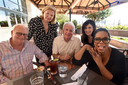 """From left, attorney Arnold Weiner, former """"People Are Talking"""" producer Arleen Weiner, retiredWJZ newscaster Richard Sher and his wife, Annabelle Sher, join Oprah Winfrey for lunch at Wit & Wisdom in Harbor East on Thursday."""