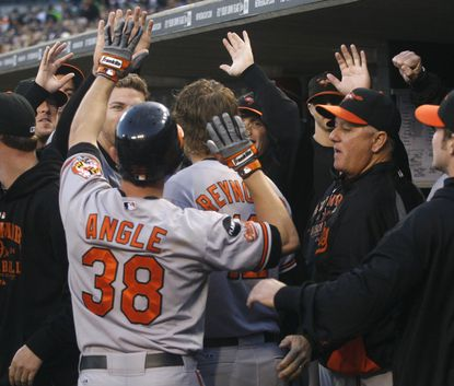Matt Angle is congratulated by his Orioles teammates after leading off the game with a solo homer against the host Tigers.