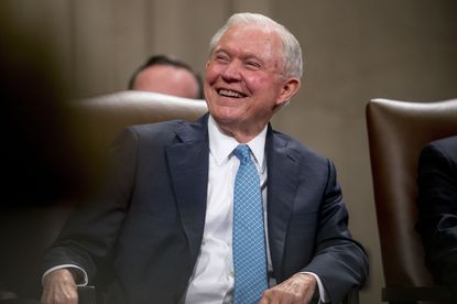 Former Attorney General Jeff Sessions smiles during a farewell ceremony for Deputy Attorney General Rod Rosenstein in the Great Hall at the Department of Justice in Washington. Sessions is planning to run for his former Senate seat in Alabama.
