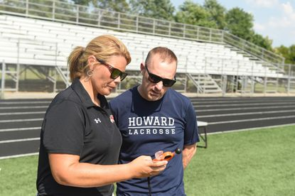 Michael Duffy, left, shown in this file photo from his time as athletic director at Howard High School, is the new athletic director for Carroll County Public Schools.