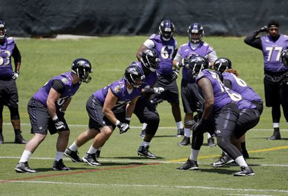 Members of the Ravens run a drill during an NFL football practice at the team's practice facility in Owings Mills, Md., Tuesday, June 7, 2016.
