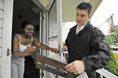 Resident Keyona Godfrey was willing to sign the petition. Pasadena Councilman Derek Fink was knocking on doors on Kings Bench Place in the Chesterfield neighborhood of Pasadena, collecting signatures to put the illegal immigrant tuition repeal on the ballot.